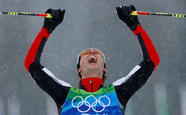 Austria's Mario Stecher crosses the finish line to winning the gold medal during the Men's Nordic Combined team event at the Vancouver 2010 Olympics in Whistler, British Columbia, Canada, Tuesday, Feb. 23, 2010. (AP Photo/Dmitry Lovetsky)