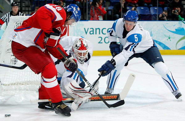 Czech Republic's Jaromir Jagr, left, has the puck poked away by Finland defenseman Lasse Kukkonen (5) in front of Finland goalie Miikka Kiprusoff during the first period of a men's quarterfinal round ice hockey game at the Vancouver 2010 Olympics in Vancouver, British Columbia, Wednesday, Feb. 24, 2010. (AP Photo/Gene J. Puskar)
