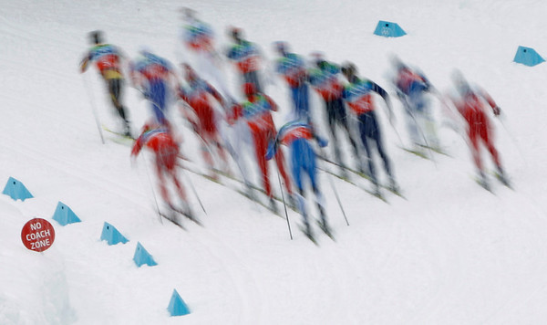 The pack climbs a hill during a classic leg of the Men's 4x10k relay at the Vancouver 2010 Olympics in Whistler, British Columbia, Canada, Wednesday, Feb. 24, 2010. (AP Photo/Matthias Schrader)