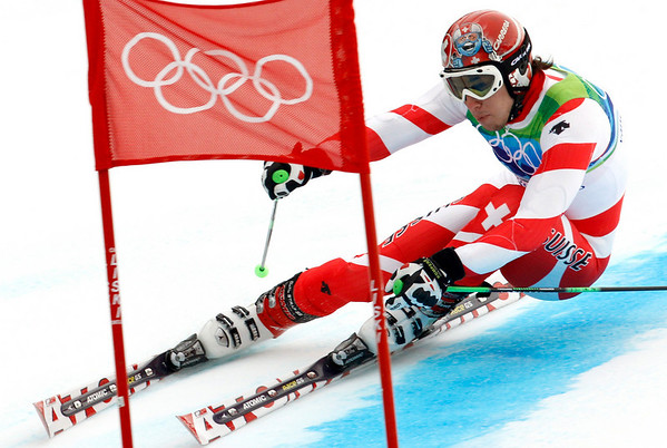 Switzerland's Carlo Janka passes a gate during the first run of the Men's giant slalom, at the Vancouver 2010 Olympics in Whistler, British Columbia, Canada, Tuesday, Feb. 23, 2010. (AP Photo/Luca Bruno)