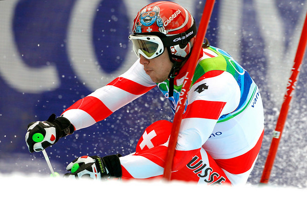 Switzerland's Carlo Janka races on his way to clinch the gold medal in the Men's giant slalom, at the Vancouver 2010 Olympics in Whistler, British Columbia, Canada, Tuesday, Feb. 23, 2010. (AP Photo/Charlie Krupa)