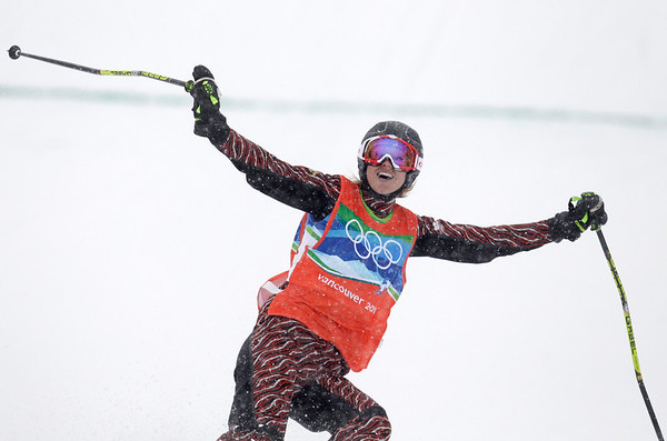 Ashleigh McIvor of Canada celebrates as she crosses the finish line to become Olympic champion in the women's skicross at the Vancouver 2010 Olympics in Vancouver, British Columbia, Tuesday, Feb. 23, 2010. (AP Photo/Marcio Sanchez)
