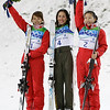 Olympic champion, Lydia Lassila of Australia, center celbrates her win with runner up, Li Nina of China, left and third placed, Guo Xinxin of China, right, after the women's freestyle skiing aerials final at the Vancouver 2010 Olympics in Vancouver, British Columbia, Wednesday, Feb. 24, 2010. (AP Photo/Marcio Sanchez)