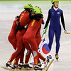 The Chinese team, at left, react after winning the gold medal for the women's 3000m relay short track skating competition, as South Korea Cho Ha-Ri, right, looks on after her team was disqualified, at the Vancouver 2010 Olympics in Vancouver, British Columbia, Wednesday, Feb. 24, 2010. (AP Photo/Mark Baker)