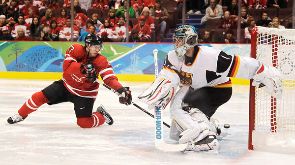 Canada's Sidney Crosby (87) scores past Germany's Thomas Greiss (1) in the third period of a men's playoff qualifying round ice hockey game at the Vancouver 2010 Olympics in Vancouver, British Columbia, Tuesday, Feb. 23, 2010. Canada won the game 8-2. (AP Photo/Julie Jacobson)