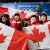 Gold medalists Canada's CAN-1, pilot Kaillie Humphries, second from right and brakeman Heather Moyse, far right, and silver medalists Canada's CAN-2, pilot Helen Upperton, and brakeman Shelley-Ann Brown, left, celebrate during the flower ceremony after the women's two-man bobsled competition final at the Vancouver 2010 Olympics in Whistler, British Columbia, Wednesday, Feb. 24, 2010. (AP Photo/Michael Sohn)