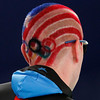The Olympic Rings and the American flag are seen in USA's Ryan Bedford's hair prior to the start of the men's 10,000 meters race at the Richmond Olympic Oval at the Vancouver 2010 Olympics in Vancouver, British Columbia, Tuesday, Feb. 23, 2010. (AP Photo/Matt Dunham)