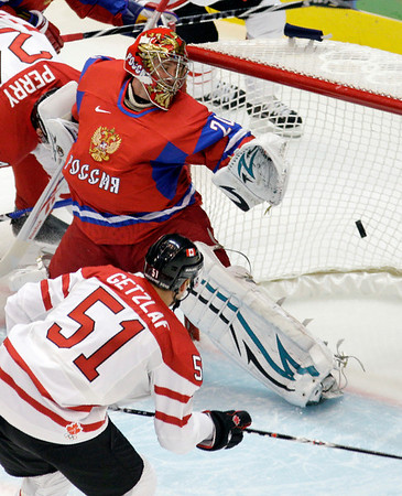 Canada's Ryan Getzlaf (51) scores a goal past Russia goalie Evgeni Nabokov (20) during the first period of a men's quarterfinal round ice hockey game at the Vancouver 2010 Olympics in Vancouver, British Columbia, Wednesday, Feb. 24, 2010. (AP Photo/Jae C. Hong)