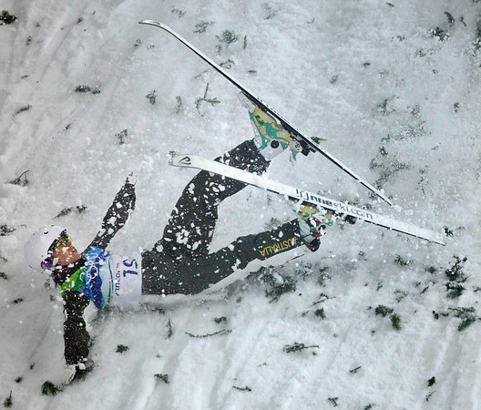 Elizabeth Gardener of Australia crashes on impact in her first jump in the women's freestyle skiing aerials final at the Vancouver 2010 Olympics in Vancouver, British Columbia, Wednesday, Feb. 24, 2010. (AP Photo/Marcio Sanchez)