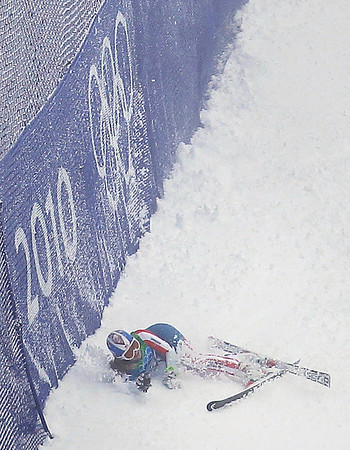 Lindsey Vonn of the United States lays in the snow after crashing during the first run of the Women's giant slalom at the Vancouver 2010 Olympics in Whistler, British Columbia, Wednesday, Feb. 24, 2010.  (AP Photo/Sergey Ponomarev)