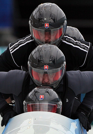 Slovakia's SVK-1 piloted by Milan Jagnesak, front, practices during a training run for the men's four-man bobsled at the Vancouver 2010 Olympics in Whistler, British Columbia, Tuesday, Feb. 23, 2010. (AP Photo/Ricardo Mazalan)