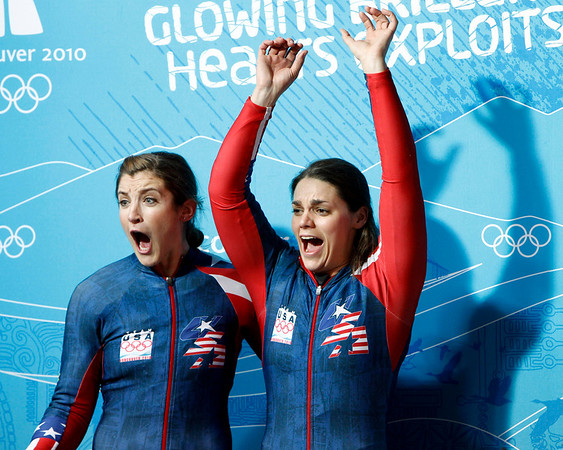 The United States' USA-3, piloted by Bree Schaaf, with brakeman Emily Azevedo, right, react after the women's two-man bobsled competition final at the Vancouver 2010 Olympics in Whistler, British Columbia, Wednesday, Feb. 24, 2010. (AP Photo/Michael Sohn)