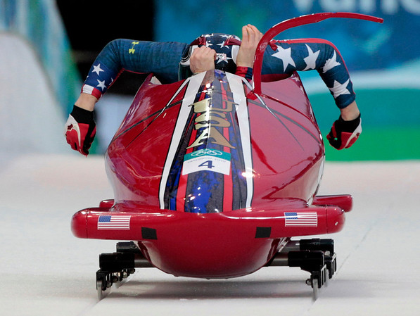 The United States' USA-1, piloted by Shauna Rohbock, with brakeman Michelle Rzepka, start during the women's two-man bobsled competition final at the Vancouver 2010 Olympics in Whistler, British Columbia, Wednesday, Feb. 24, 2010. (AP Photo/Elise Amendola)