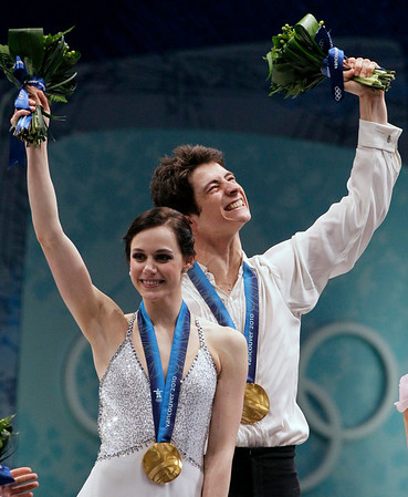 Canada's Tessa Virtue and Scott Moir react on the podium after winning the gold medal in the ice dance figure skating competition at the Vancouver 2010 Olympics in Vancouver, British Columbia, Monday, Feb. 22, 2010. (AP Photo/Amy Sancetta)