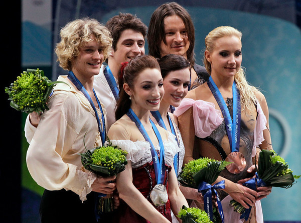 Canadian pair and gold medallists Tessa Virtue and Scott Moir, center, U.S. pair and silver medallists Meryl Davis and Charlie White, left, and Russian pair and bronze medallists Oksana Domnina and Maxim Shabalin, right, are seen on the podium during the medals ceremony for the ice dance figure skating competition at the Vancouver 2010 Olympics in Vancouver, British Columbia, Monday, Feb. 22, 2010. (AP Photo/Amy Sancetta)