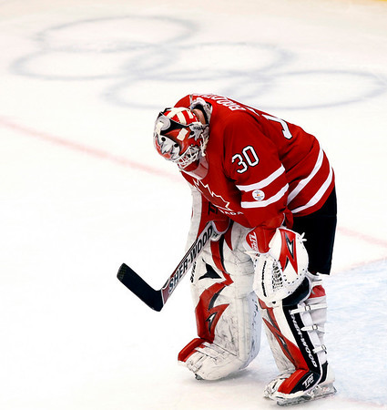 Canada's goaltender Martin Brodeur reacts after letting in the fourth goal by team  U.S.A. during third period men's ice hockey action Sunday, Feb. 21, 2010 at the 2010 Winter Olympic Games in Vancouver, British Columbia. USA won 5-3. (AP Photo/The Canadian Press, Ryan Remiorz)