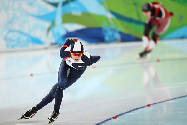 Bronze medallist Czech Republic's Martina Sablikova, left, competes agains Canada's Brittany Schussler, top right rear, during the women's 1,500 meter speed skating race at the Richmond Olympic Oval at the Vancouver 2010 Olympics in Vancouver, British Columbia, Sunday, Feb. 21, 2010.  (AP Photo/Matt Dunham)