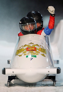 Russia's RUS-1, piloted by Alexsandr Zubkov, front, with brakeman Alexey Voevoda, celebrate in the finish area during the men's two-man bobsled final competition at the Vancouver 2010 Olympics in Whistler, British Columbia, Sunday, Feb. 21, 2010. RUS-1 won the bronze medal. (AP Photo/Ricardo Mazalan)