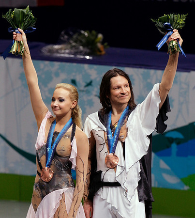 Russia's Oksana Domnina and Maxim Shabalin react on the podium after winning the bronze medal in the ice dance figure skating competition at the Vancouver 2010 Olympics in Vancouver, British Columbia, Monday, Feb. 22, 2010. (AP Photo/Mark Baker)