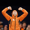 Gold medallist Netherlands's Ireen Wust reacts on the podium after the women's 1500 meters race at the Richmond Olympic Oval at the Vancouver 2010 Olympics in Vancouver, British Columbia, Sunday, Feb. 21, 2010. (AP Photo/Kevin Frayer)