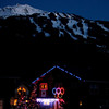 Olympic spirit shines on the side of a home in Whistler, British Columbia, during the Vancouver 2010 Olympics, Sunday, Feb. 21, 2010. (AP Photo/Charlie Riedel)