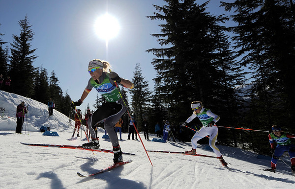 Germany's Claudia Nystad, gold, Sweden's Anna Haag, silver, and Russia's Natalia Korosteleva, bronze, from left, ski during the Women's Cross Country team sprint freestyle final at the Vancouver 2010 Olympics in Whistler, British Columbia, Canada, Monday, Feb. 22, 2010. (AP Photo/Jens Meyer)