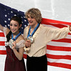 USA's Meryl Davis and Charlie White hold their medals up during the victory lap after winning the silver medal in the ice dance figure skating competition pose with silver at the Vancouver 2010 Olympics in Vancouver, British Columbia, Monday, Feb. 22, 2010. (AP Photo/Mark Baker)