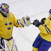Sweden's Nicklas Backstrom congratulates goalie Henrik Lundqvist after Sweden beat Finland 3-0 in a preliminary round men's ice hockey game at the Vancouver 2010 Olympics in Vancouver, British Columbia, Sunday, Feb. 21, 2010. (AP Photo/Matt Slocum)