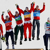Austrian team, from left, Austria's Wolfgang Loitzl, Austria's Andreas Kofler, Austria's Thomas Morgenstern and Austria's Gregor Schlierenzauer celebrate winning the gold medal during the flower ceremony of the Men's ski jumping team event from the large hill at the Vancouver 2010 Olympics in Whistler, British Columbia, Canada, Monday, Feb. 22, 2010. (AP Photo/Matthias Schrader)
