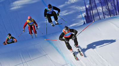 Michael Schmid of Switzerland, right, Andreas Matt of Austria, 2nd right, Christopher Del Bosco of Canada, left and Audun Groenvold of Norway, 2nd left compete in the men's skicross final  at the Vancouver 2010 Olympics in Vancouver, British Columbia, Sunday, Feb. 21, 2010. (AP Photo/Bela Szandelszky)