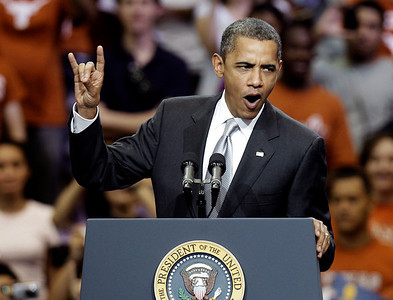 "President Barack Obama gives a ""hook 'em horns"" sign as he starts a speech at Gregory Gym at the University of Texas in Austin, Texas, Monday, Aug. 9, 2010.   (AP Photo/LM Otero)"