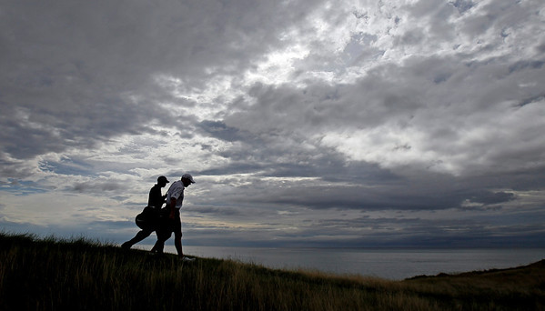 Tiger Woods and caddie Steve Williams walk up the 16th hole during a practice round for the PGA Championship golf tournament Monday, Aug. 9, 2010, at Whistling Straits in Haven, Wis. (AP Photo/Charlie Neibergall)