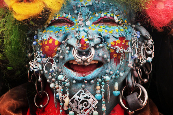 The face of Elaine Davidson, who, according to Guinness World Records is the  'Most Pierced Woman',  performs on the Royal Mile  during the Edinburgh Fringe Festival,  in Edinburgh, Scotland,  on Monday Aug. 9,  2010. (AP Photo / David Cheskin, PA)
