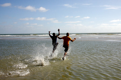 "Ed Stafford, of England, right, accompanied by Gadiel ""Cho"" Sanchez Rivera, of Peru, runs along Crispim beach in Marapanim in Brazil's Para state, Monday Aug. 9, 2010.  After 859 days and thousands of miles Ed Stafford became the first man known to have walked the entire length of the Amazon river. (AP Photo/Renato Chalu)"