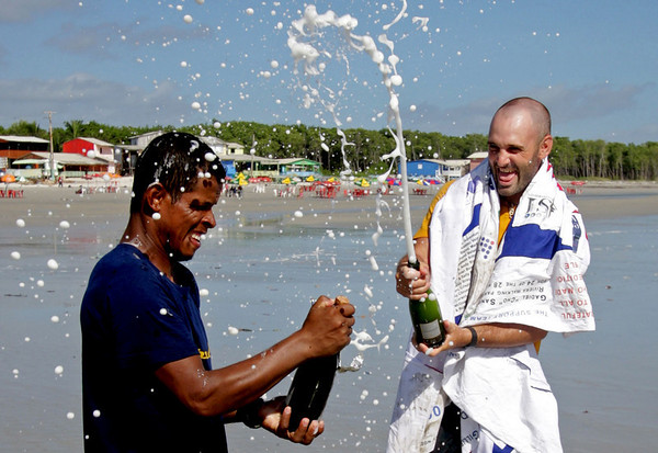 "Ed Stafford, of England, right, and Gadiel ""Cho"" Sanchez Rivera, of Peru, celebrate arriving to Crispim beach in Marapanim in Brazil's Para state, Monday Aug. 9, 2010. After 859 days and thousands of miles Ed Stafford became the first man known to have walked the entire length of the Amazon river.  (AP Photo/Renato Chalu)"