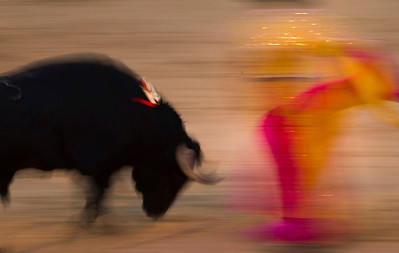 Spanish bullfighter Victor Puerto performs during a bullfight at the Las Ventas Bullring in Madrid, Sunday, Aug. 15, 2010. Bullfighting is an ancient tradition in Spain and the season runs from March to October. (AP Photo/Daniel Ochoa de Olza)