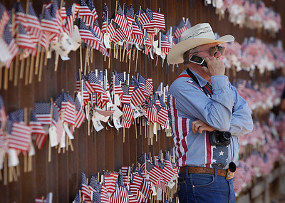 David Walker, a Southern Arizona rancher, stands at the border wall with Mexico on Sunday, Aug. 15, 2010 in Hereford, Ariz. Walker was attending the United Border Coalition Tea Party Rally in support of Arizona's immigration law, SB1070 with conservative tea party activists along a remote stretch of the Arizona-Mexico border about 70 miles (113 kilometers) west of Nogales.(AP Photo/Matt York)