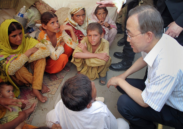 U.N. Secretary-General Ban Ki-moon talks to children at a camp during his visit to flood affected areas in Muzaffargarh, in central Pakistan on Sunday, Aug. 15, 2010.. Ban says he has never seen a disaster as bad as the flooding in Pakistan. Ban is urging foreign donors to speed up assistance to the some 20 million people affected. (AP Photo/Anjum Naveed)
