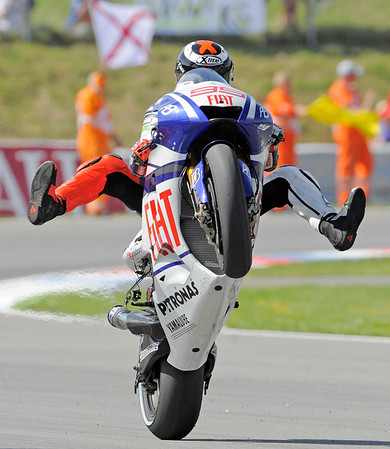 MotoGP World Championship leader Jorge Lorenzo of Spain wheelies with his Yamaha motorcycle after winning the Czech Republic Moto GP at the circuit in Brno, Czech Republic, Sunday, Aug. 15, 2010. (AP Photo/Jens Meyer)