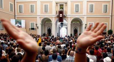 A faithful claps during Pope Benedict XVI's Angelus prayer from his summer residence in Castel Gandolfo, on the outskirts of Rome, Italy, Sunday, Aug. 15, 2010. (AP Photo/Pier Paolo Cito)