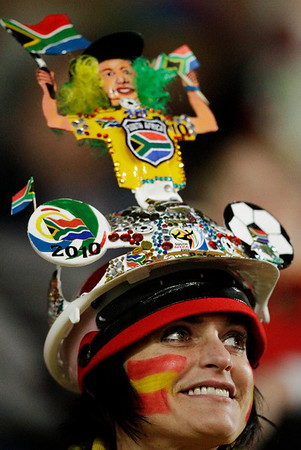 A Spain supporter waits for the start of the World Cup quarterfinal soccer match between Paraguay and Spain at Ellis Park Stadium in Johannesburg, South Africa, Saturday, July 3, 2010.  (AP Photo/Themba Hadebe)