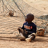 A child plays next to the goal post at a Peace Cup Tournament in Attridgeville, South Africa, Saturday, July 3, 2010. The tournament, organized by the Catholic Church and running at the same time as the soccer World Cup, is aimed to bring together fans of different social classes, ethnicity, and national origins  as well as fans from all over the world. (AP Photo/Denis Farrell)