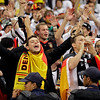 German fans celebrate at the end of the World Cup quarterfinal soccer match between Argentina and Germany at the Green Point stadium in Cape Town, South Africa, Saturday, July 3, 2010. Germany won 4-0.  (AP Photo/Schalk van Zuydam)