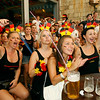 German fans react in Arenales beach in Palma de Mallorca, Spain, during their World Cup quarterfinal soccer match between Germany and Argentina on Saturday, July 3, 2010. Germany won the match 4-0. (AP Photo/Manu Mielniezuk)