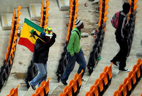 Ghana fans leaves the stadium after the World Cup quarterfinal soccer match between Uruguay and Ghana at Soccer City in Johannesburg, South Africa, Friday, July 2, 2010.  Uruguay reached the World Cup semifinals for the first time since 1970, beating Ghana 4-2 on penalties after a 1-1 draw Friday. (AP Photo/Hassan Ammar)