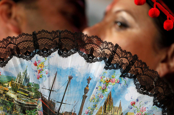 A couple kiss behind a fan before the World Cup quarterfinal soccer match between Paraguay and Spain at Ellis Park Stadium in Johannesburg, South Africa, Saturday, July 3, 2010.  (AP Photo/Bernat Armague)