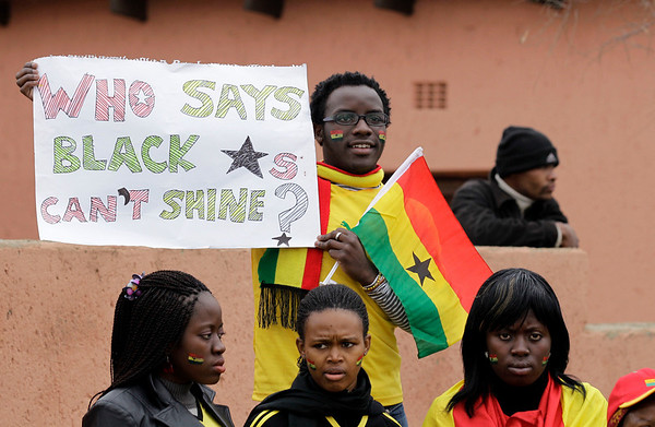 Fans of the Ghana national soccer team, the Black Stars, wait for the team's arrival in Soweto Township in Johannesburg, South Africa Sunday, July 4, 2010.  The Ghanaian team became the third African team ever to reach the World Cup quarterfinal round, where they were defeated by Uruguay. (AP Photo/Rebecca Blackwell)