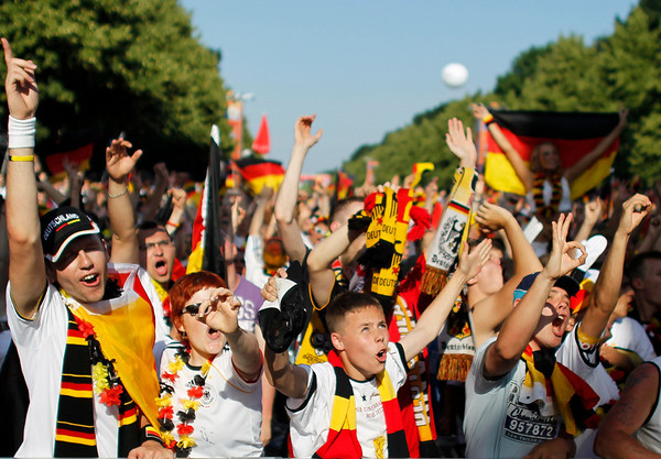 Fans of the German soccer team celebrate in Berlin, Germany, after Germany defeated Argentina 4-0 in the quarterfinal World Cup soccer match taking place in Cape Town, South Africa, on Saturday, July 3, 2010. (AP Photo/Markus Schreiber)
