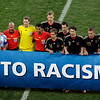 "German and Argentine players show a banner reading ""No To Racism"" prior to the World Cup quarterfinal soccer match between Argentina and Germany at the Green Point stadium in Cape Town, South Africa, Saturday, July 3, 2010.  (AP Photo/Michael Sohn)"