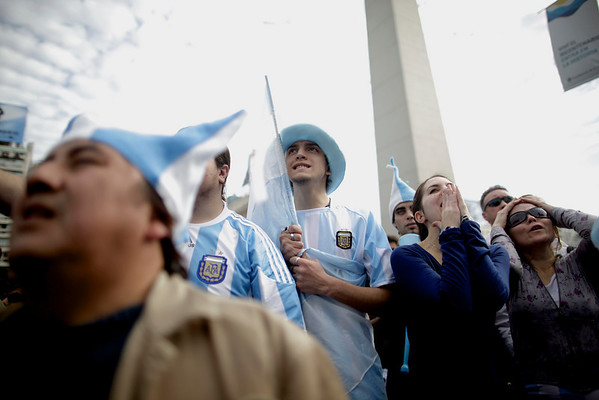 A fan of Argentina's soccer team watches what looks like a losing match against Germany, in the South Africa 2010 World Cup quarterfinals, shown to the public on a giant screen in Buenos Aires, Saturday July 3, 2010. Argentina went on to lose 4-0. (AP Photo/Natacha Pisarenko)
